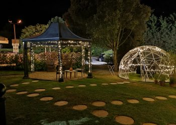 Dome lit up at night at Ivy Hill Hotel