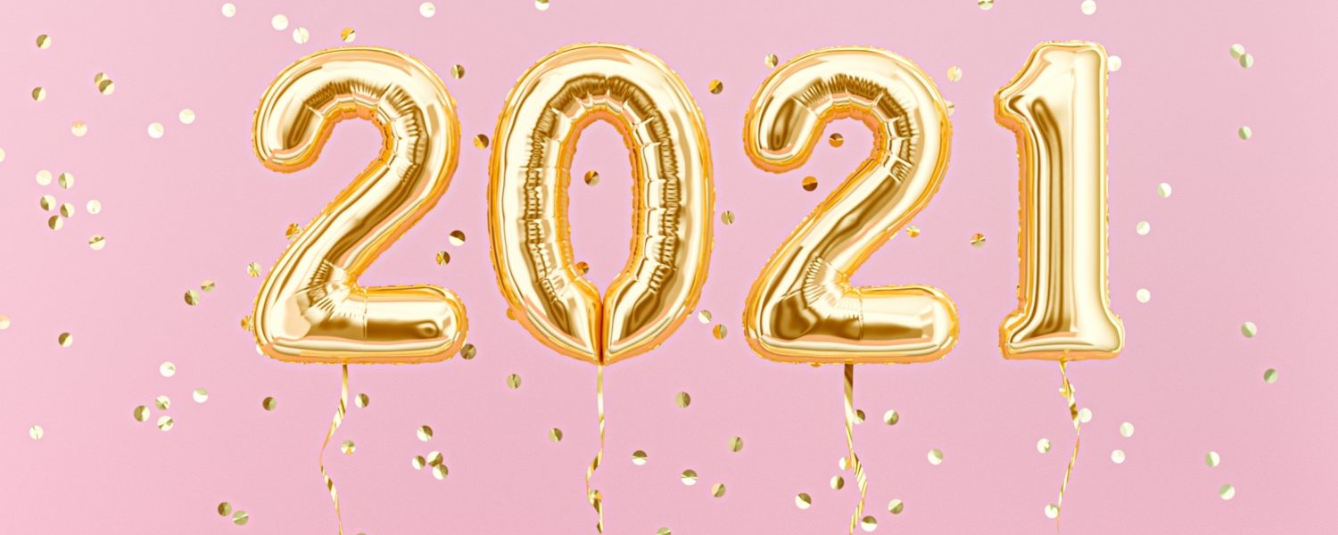 2021 in gold balloons with pink glitter background